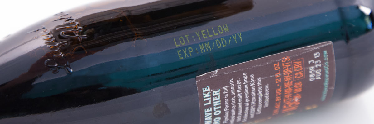 close up of an amber bottle with yellow ink
