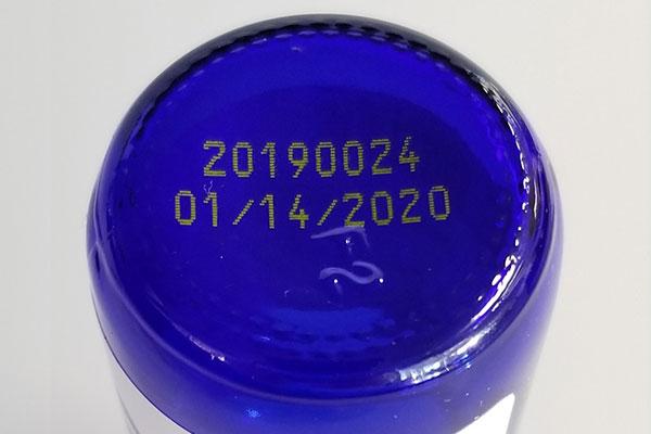 print on dark blue bottle